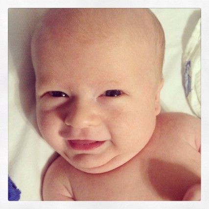 Here is my sweet boy at six weeks...smiling and laughing all day long! :)